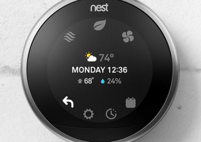 Front of a Nest thermostat used by Elite Home Performance